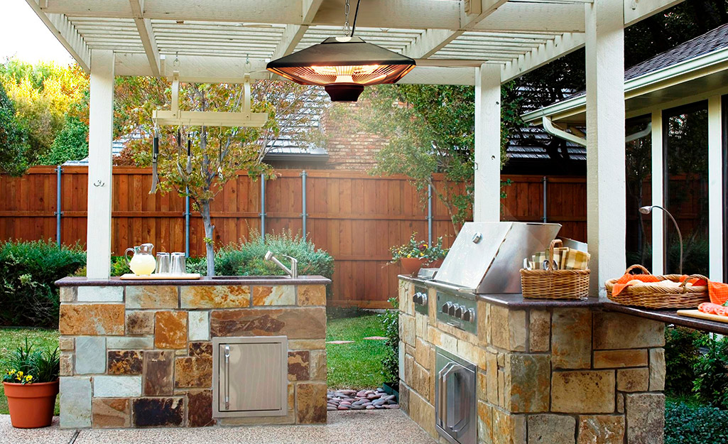 Overhead electric patio heater in an outdoor kitchen