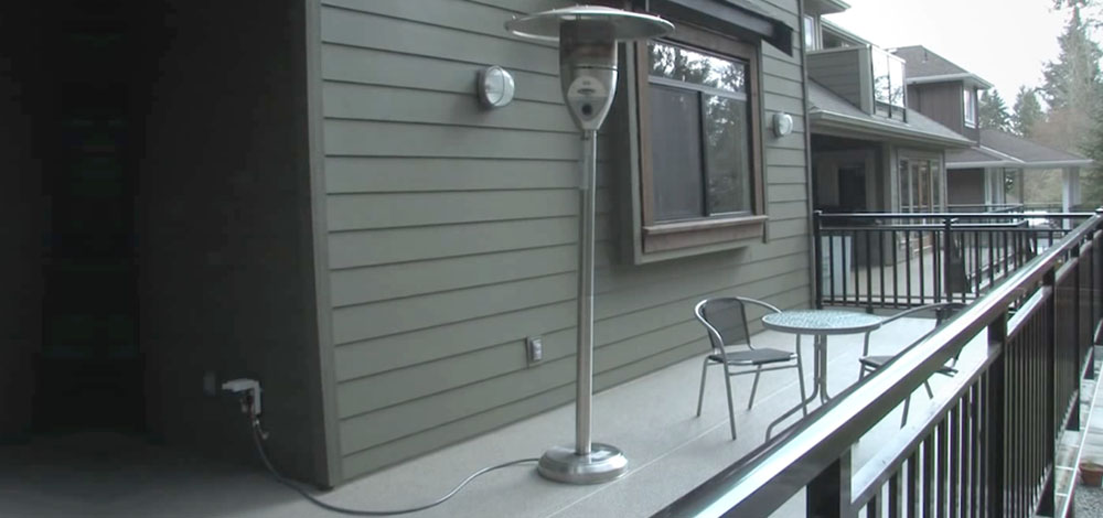 A Standing Outdoor Patio Heater On Back Porch