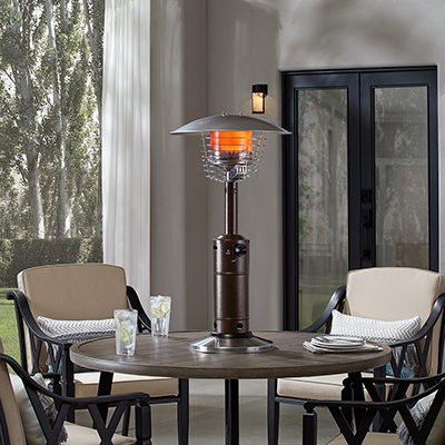 an outdoor patio heater between two patio chairs
