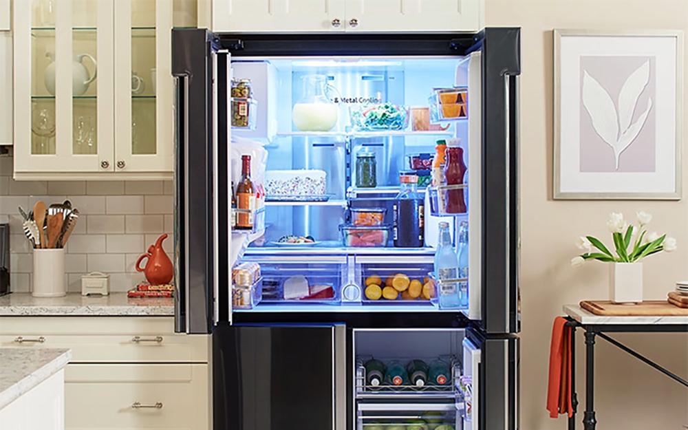 Open french door refrigerator in kitchen
