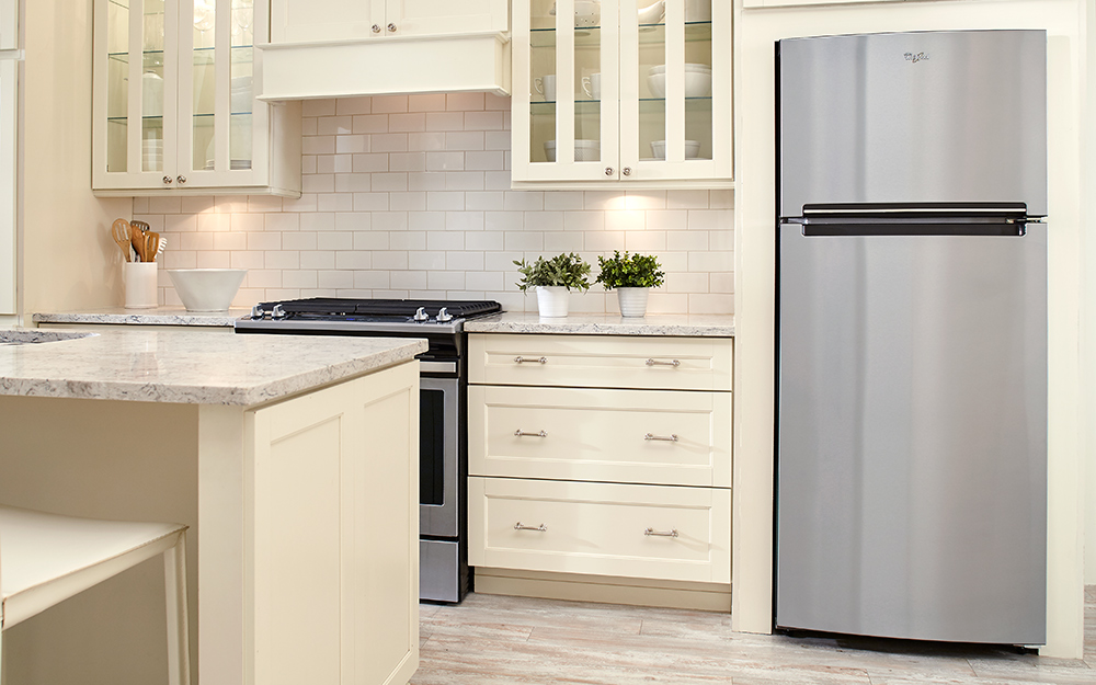 Modern kitchen with stainless steel refrigerator