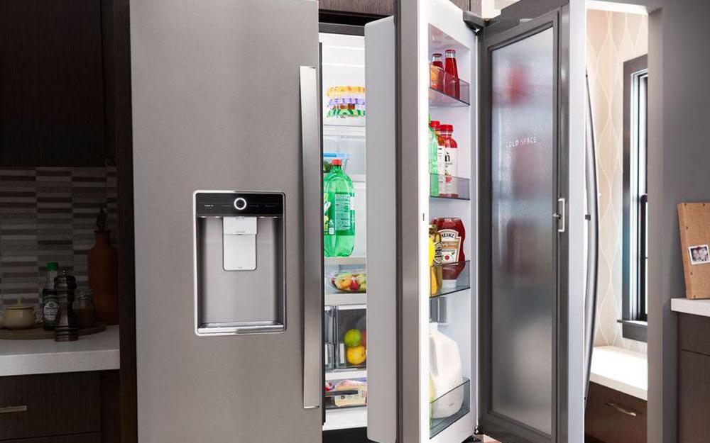 Open door-in-door refrigerator in kitchen