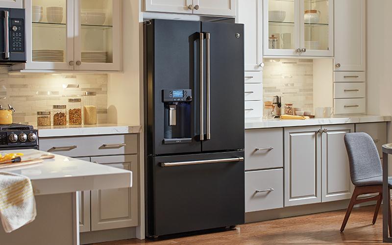 A black stainless steel refrigerator in a modern kitchen