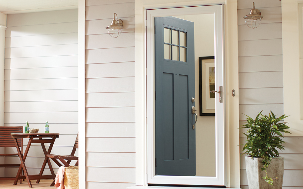 A storm door attached to an exterior door.