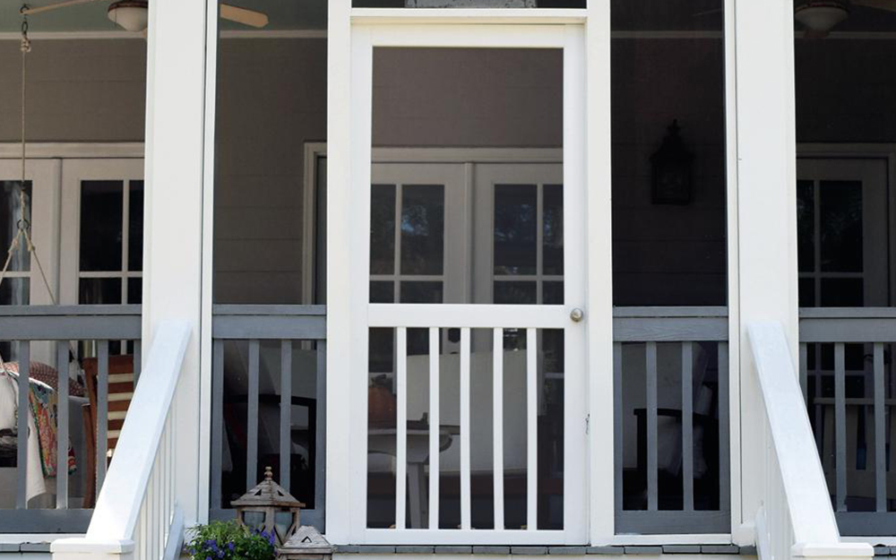 A screen door installed in front of an exterior door.