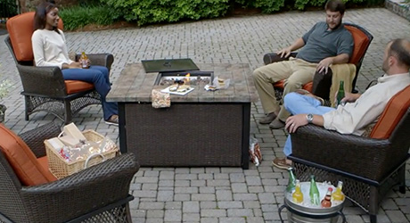 People gathering around a fire pit
