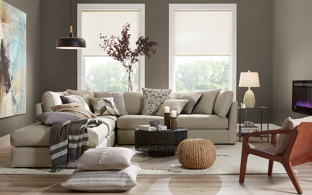 A neutral monochromatic living room filled with beige and tan furniture.