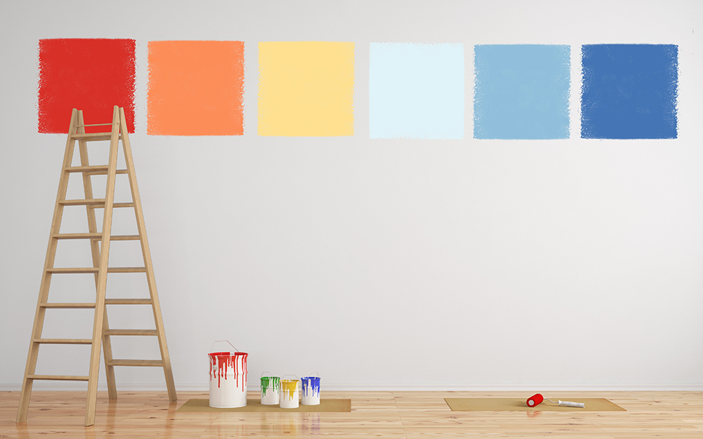 A Ladder Rests Against Wall Featuring Large Test Paint Squares
