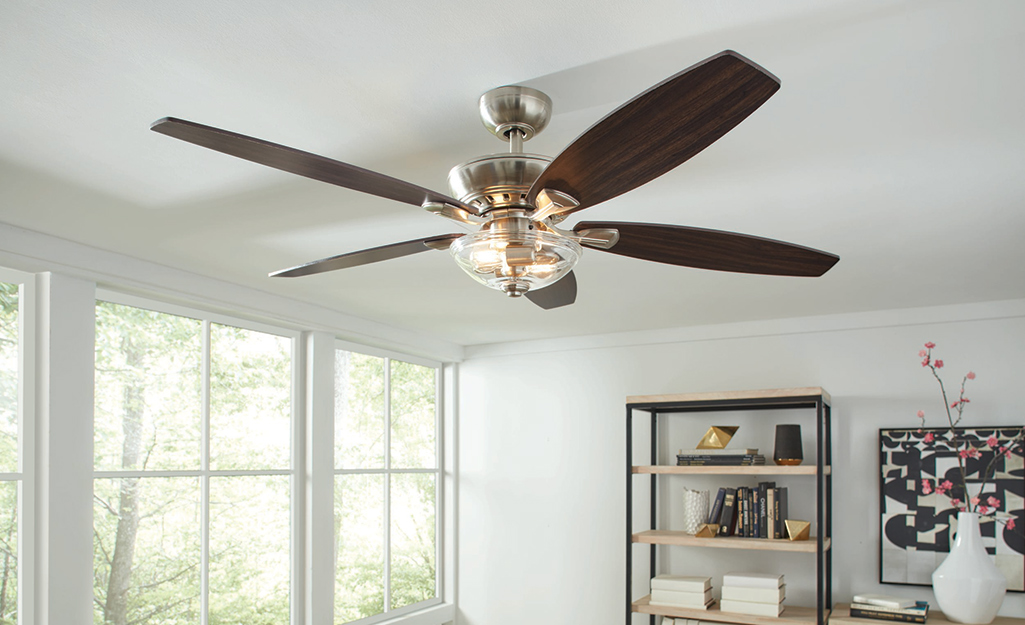 A large fan flush-mounted to a ceiling.