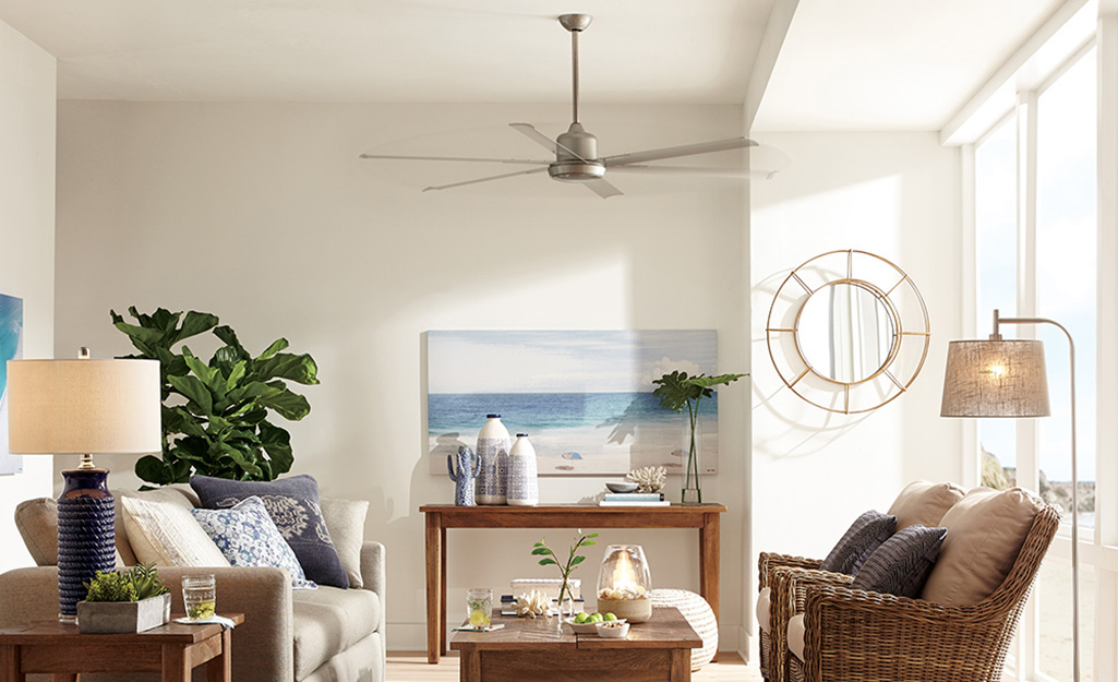 A fan installed in a coastal style living room.