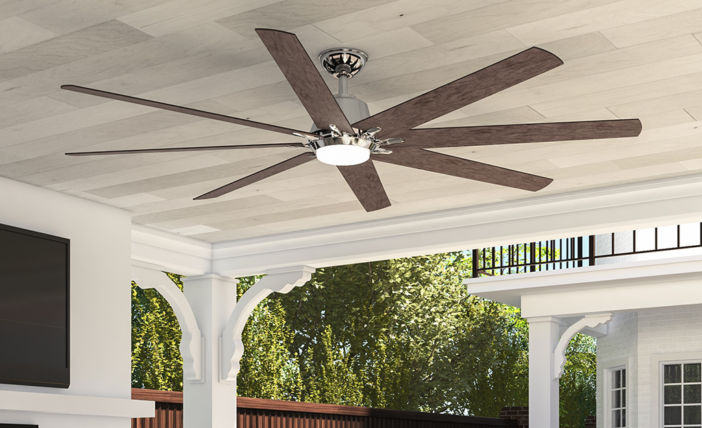 An outdoor ceiling fan installed on a patio.