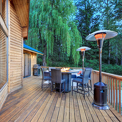 Stained wood deck area used as an outdoor dining space.