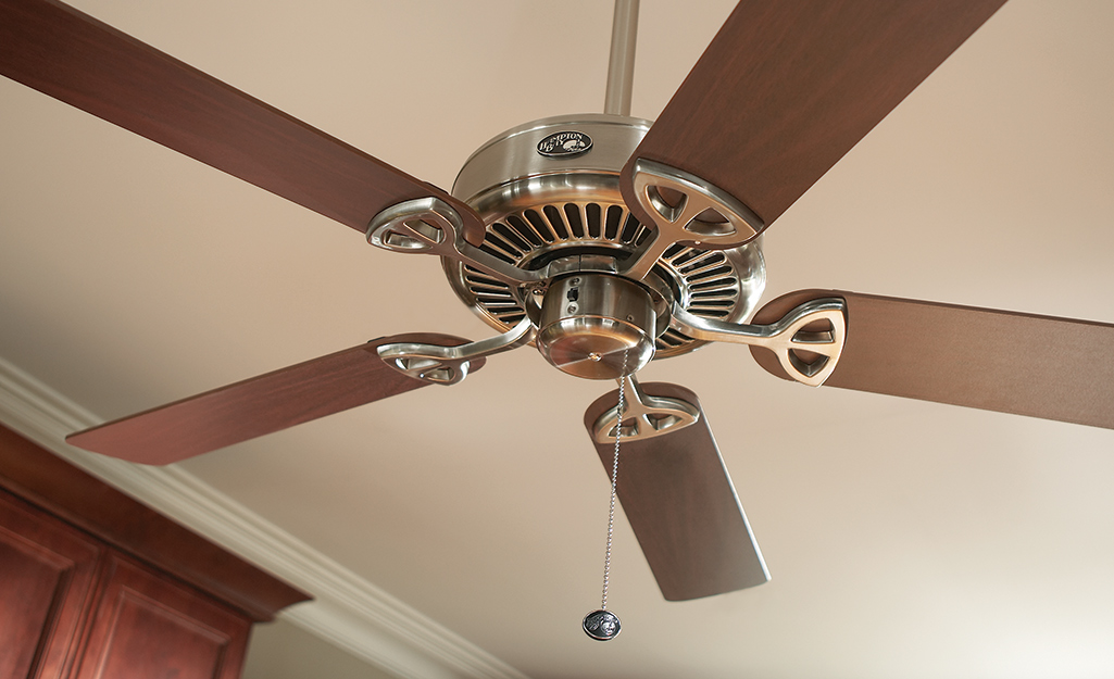 A ceiling fan with a long pull chain.