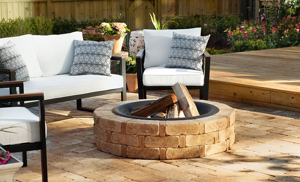 a stone fire pit in an outdoor living space
