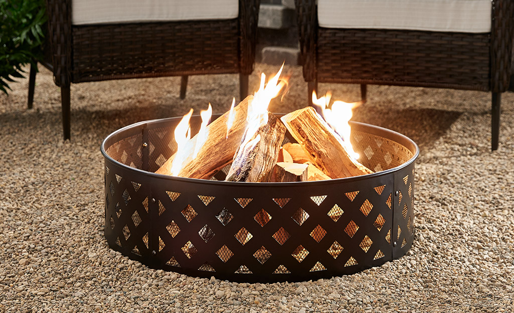 a close up image of a steel fire pit