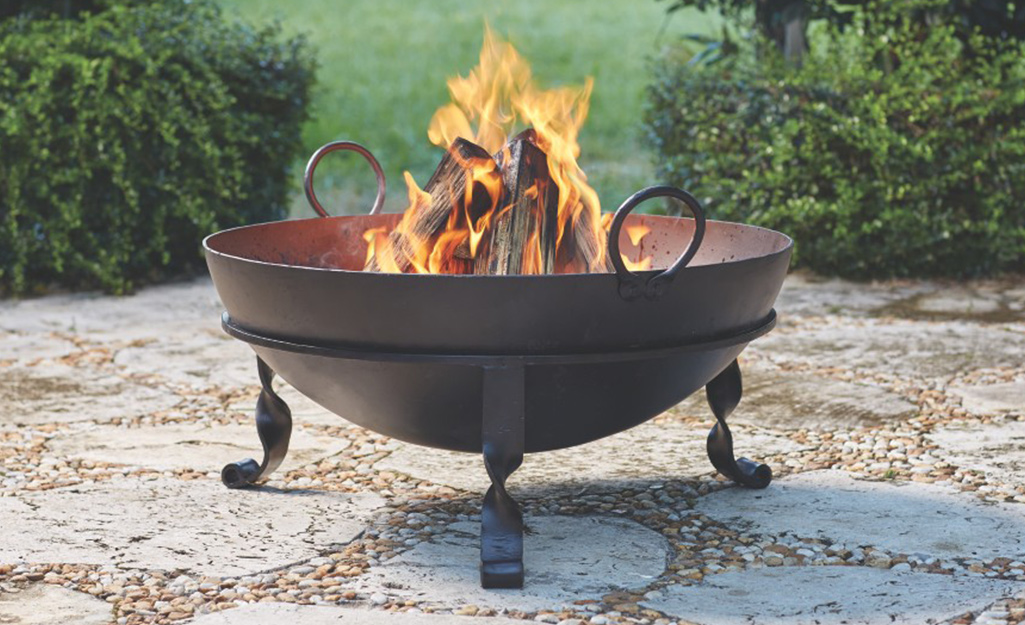 a close up of a cast iron fire pit