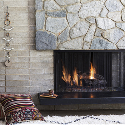A fireplace with a fire lit