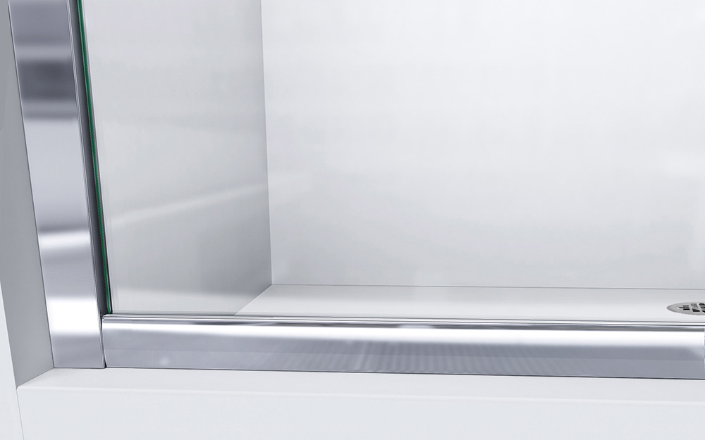 A metal track holds a clean glass shower door
