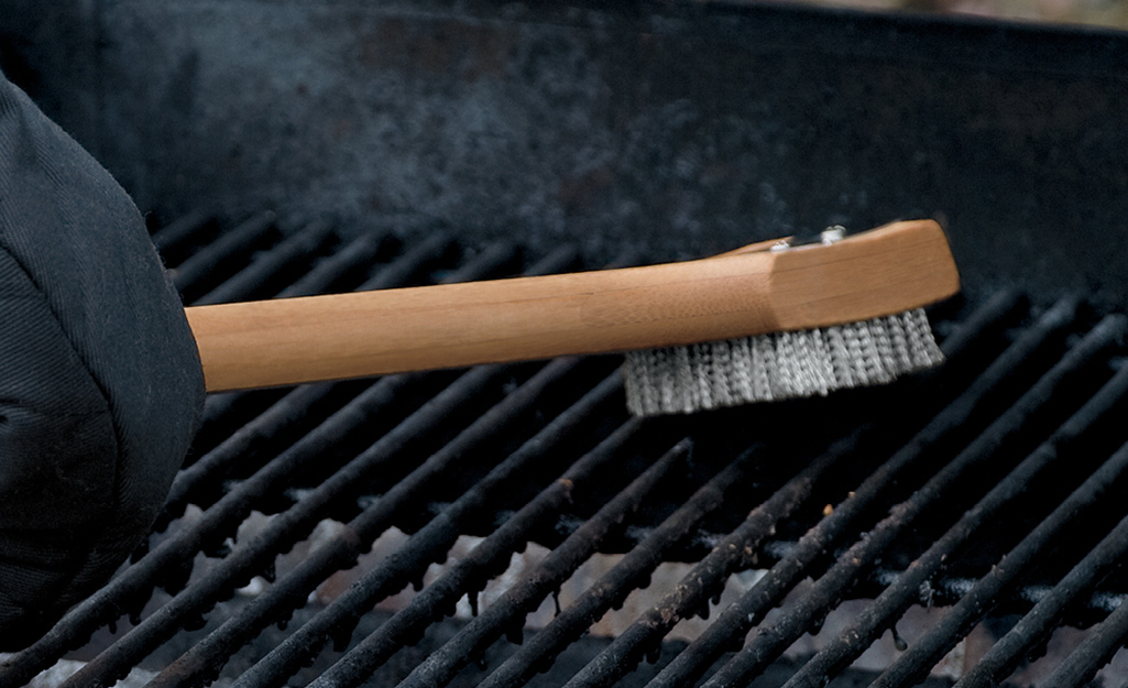 A scrubber cleaning grill grates.