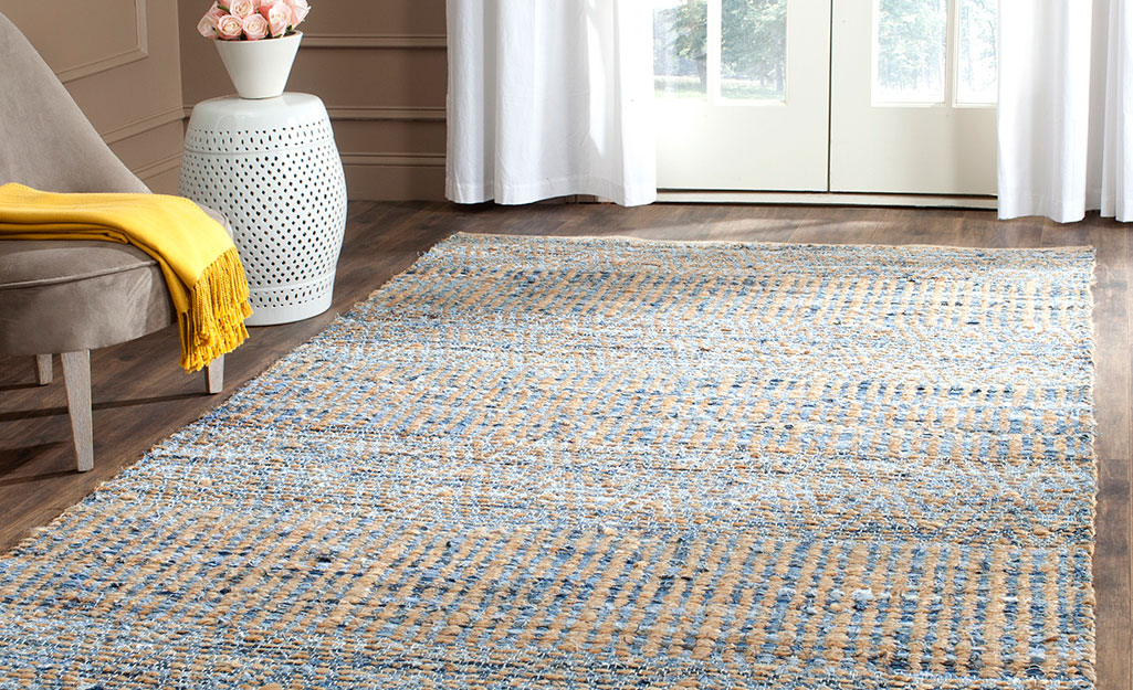 A jute rug in a living room.