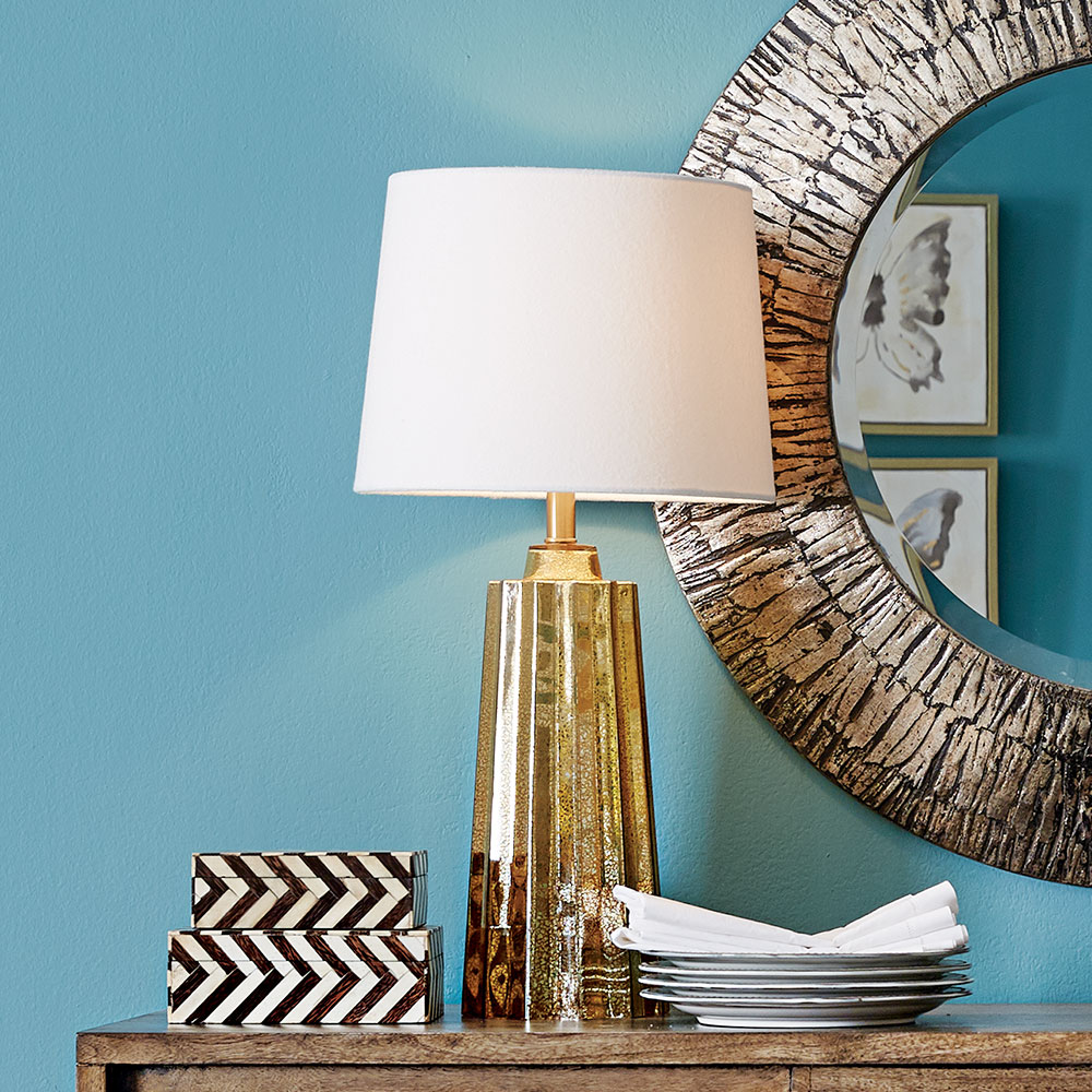 A lamp on a side table.