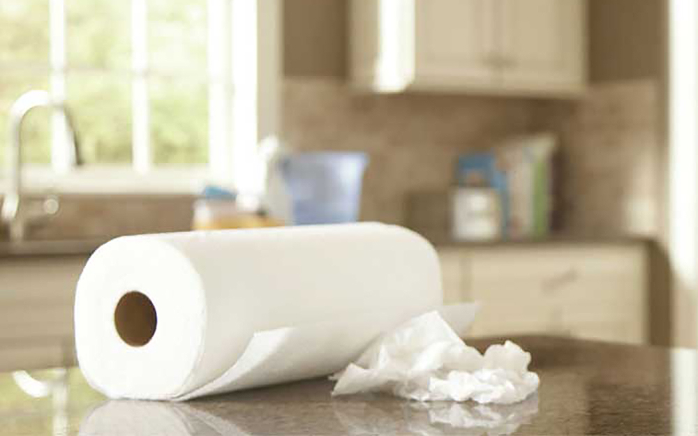 A roll of paper towels on a kitchen counter