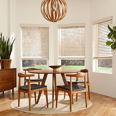 Horizontal blinds over a dining room window