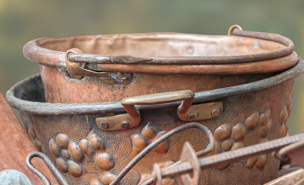 Copper tarnish appears on cookware.