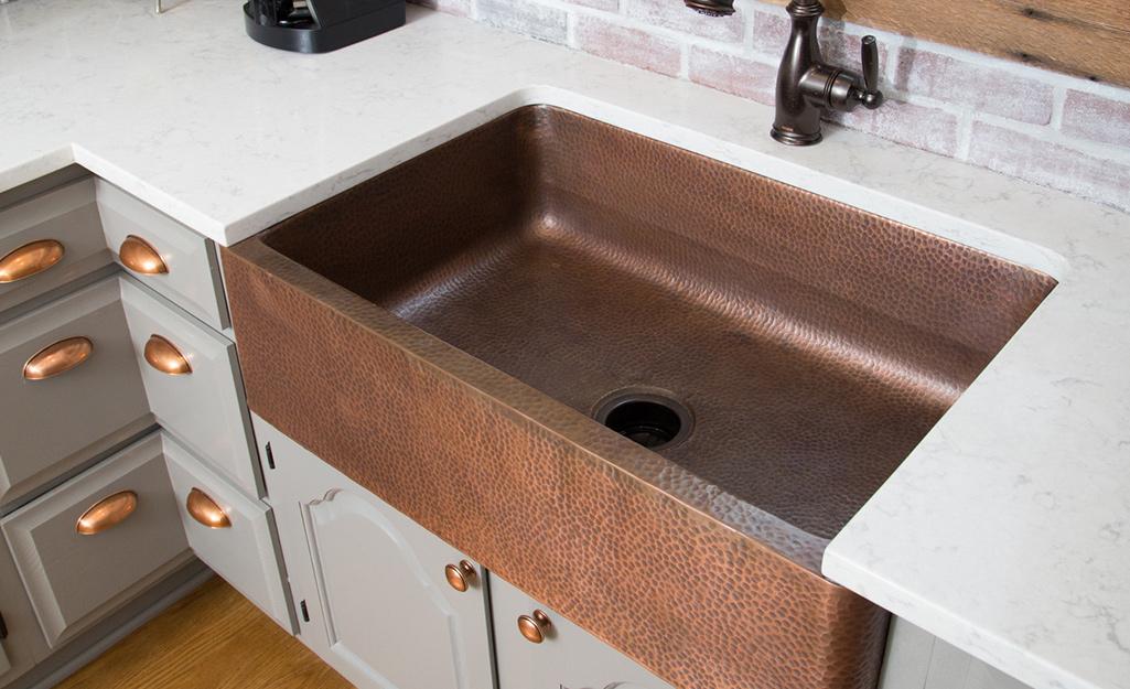 A copper sink in a kitchen.