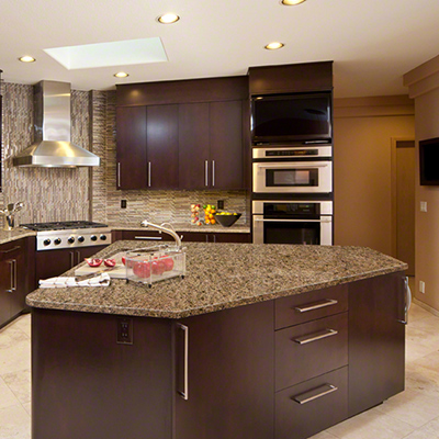 Kitchen in the company of granite countertops also stainless steel appliances.