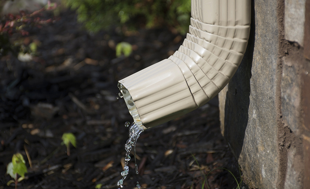 Water draining from a downspout.