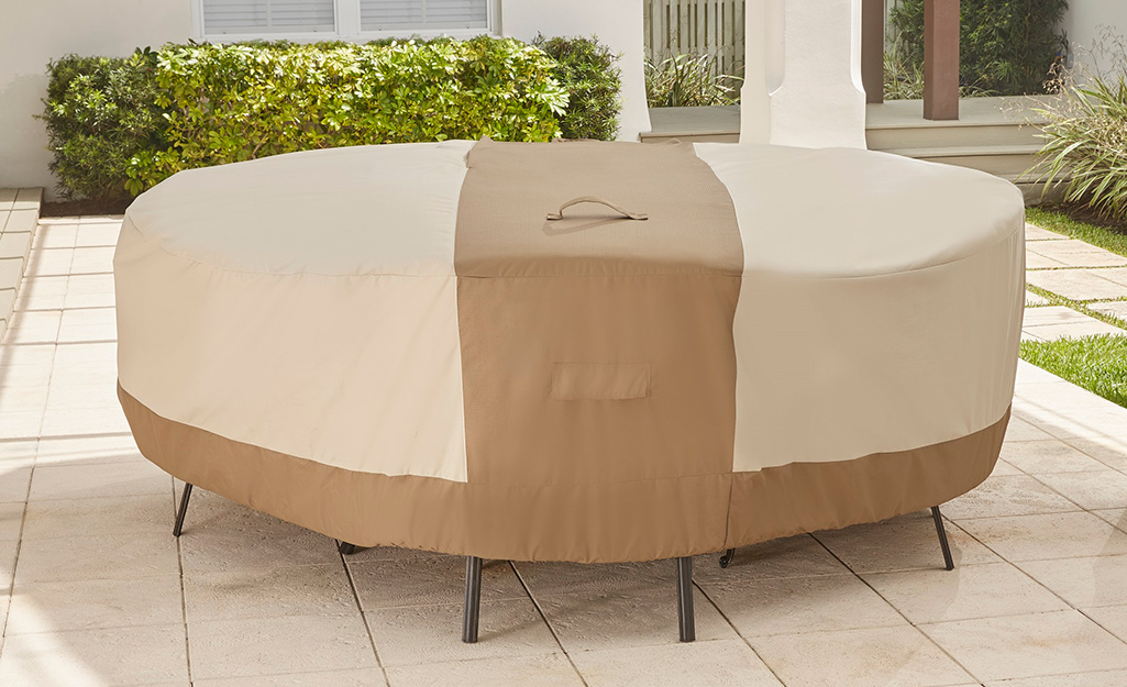 An outdoor furniture cover protecting a patio set.