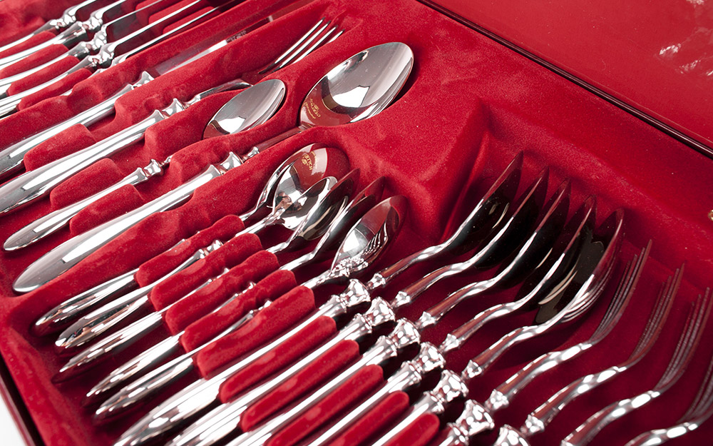 A silverware set in a padded box.