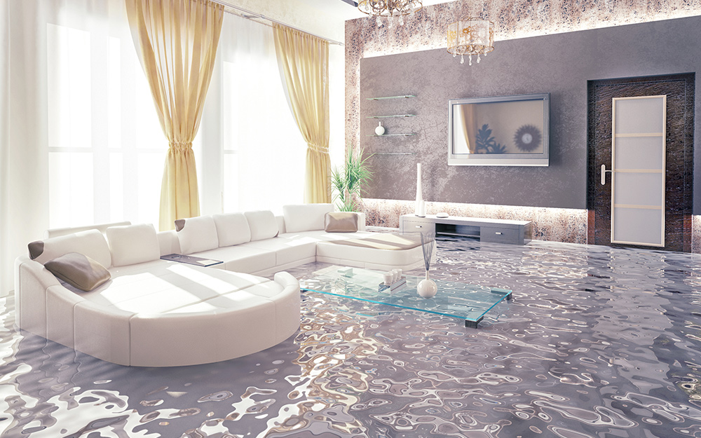 Floodwater in a living room covers a coffee table.