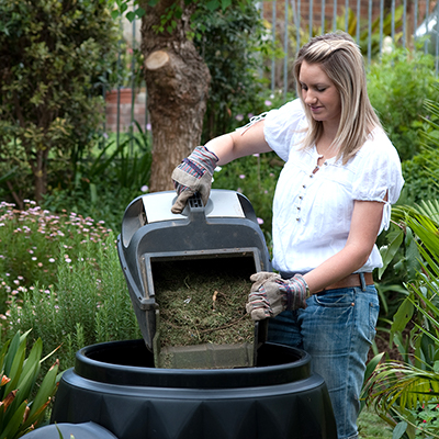 woman composting in her yard