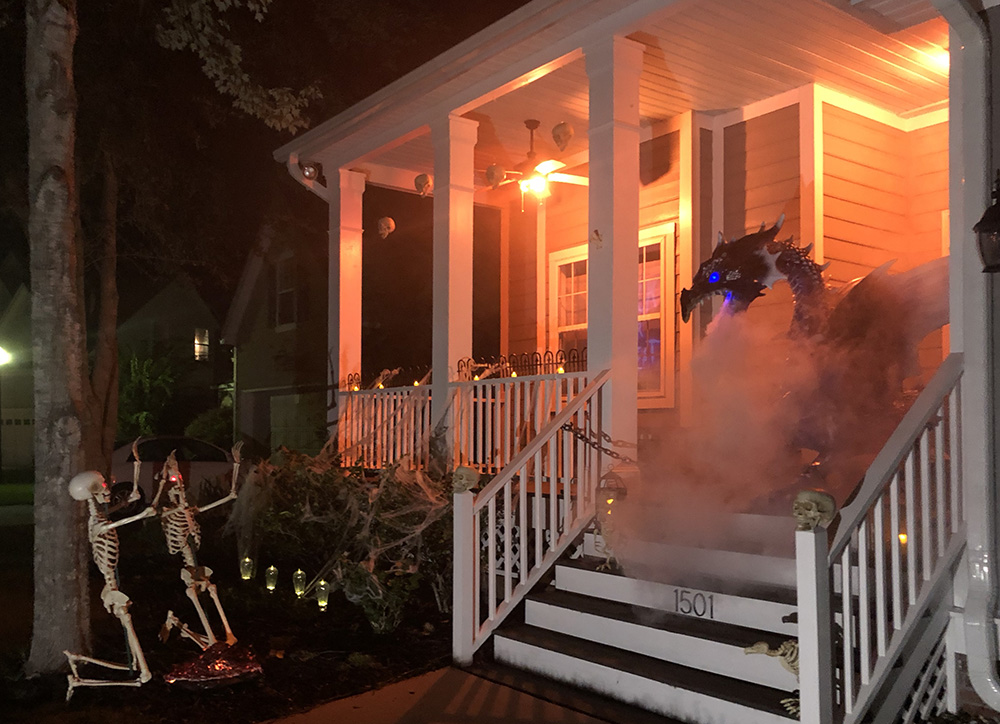 A scary Halloween porch decorated with a dragon.