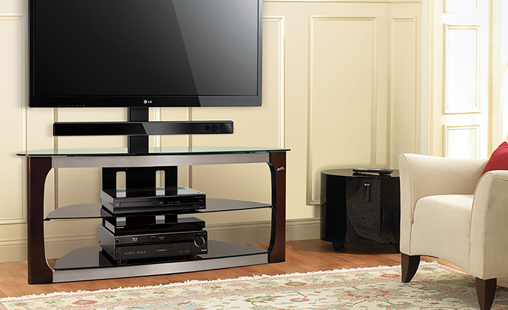 a tv with a sound bar on a stand in a living room
