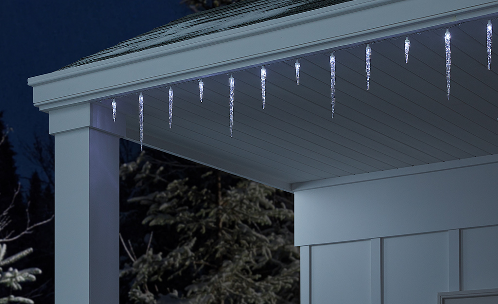 Icicle lights hanging from the top of a home.