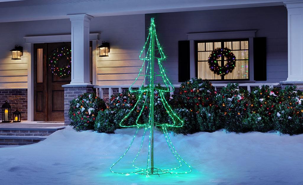 A Christmas tree light display outside a home.