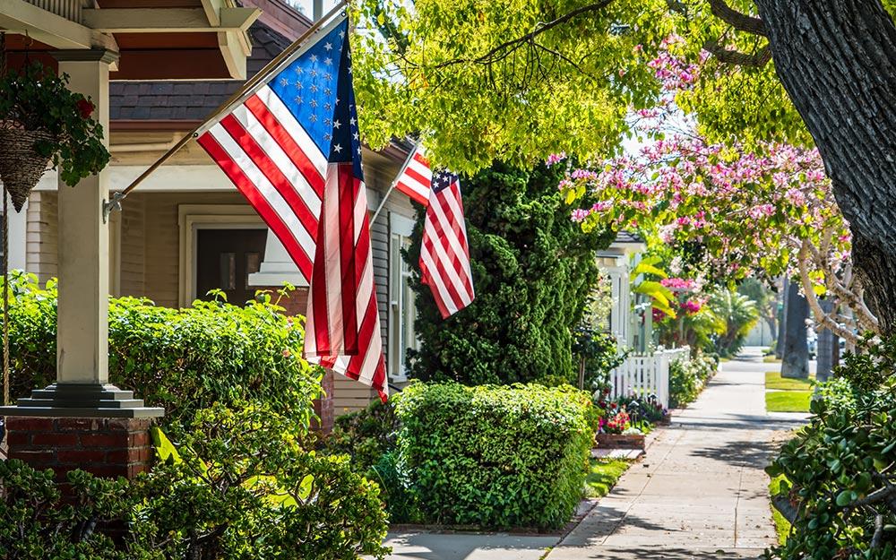 American flags hanging on a neighborhood street