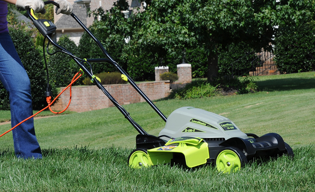 A person mowing a lawn.