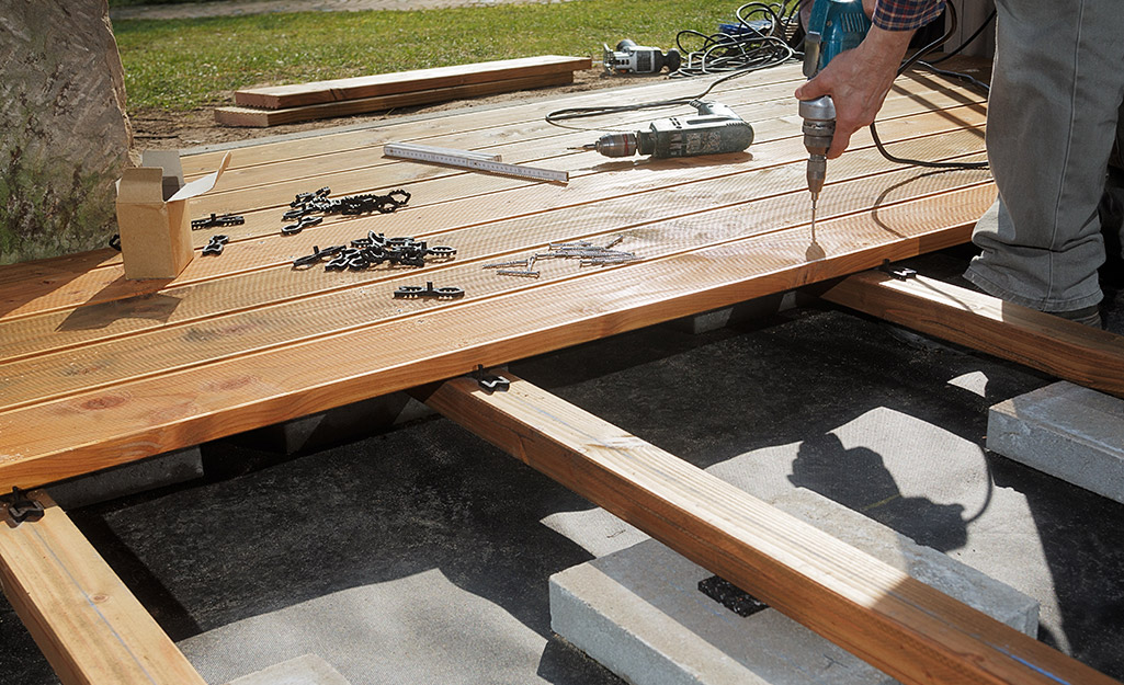 Boards are nailed down to create a deck.