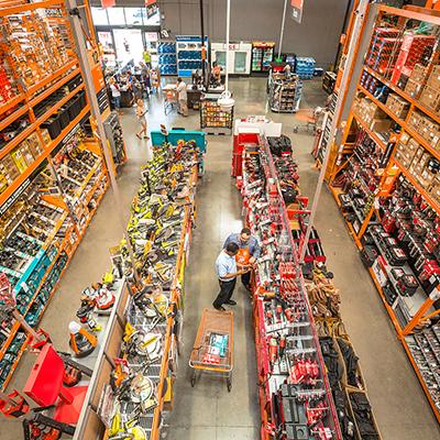 An Associate helps a customer inside The Home Depot Store