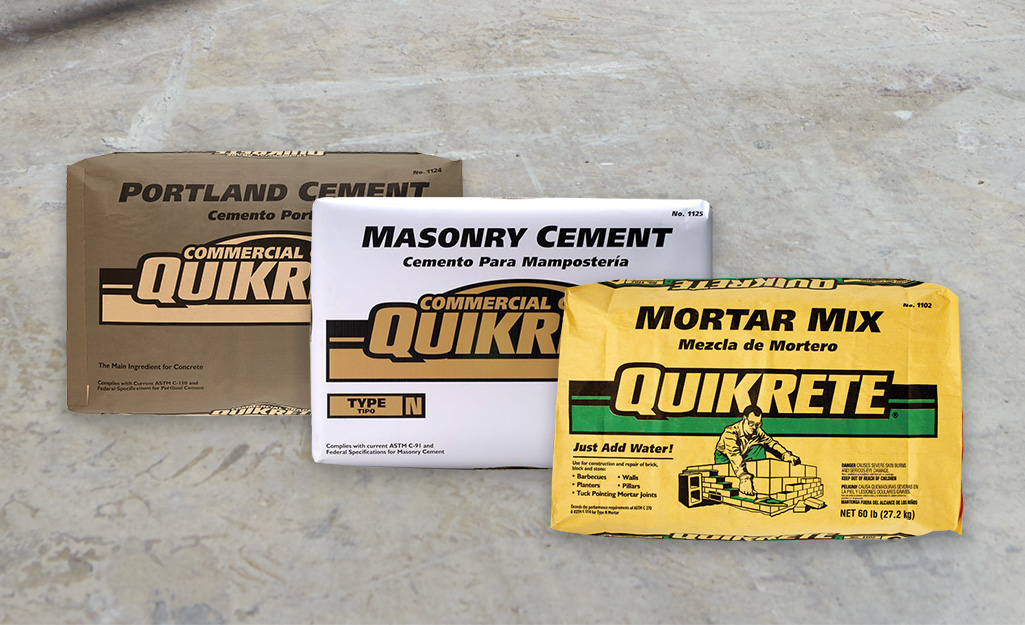 A bag of mortar mix beside a bag of masonry cement and a bag of Portland cement.