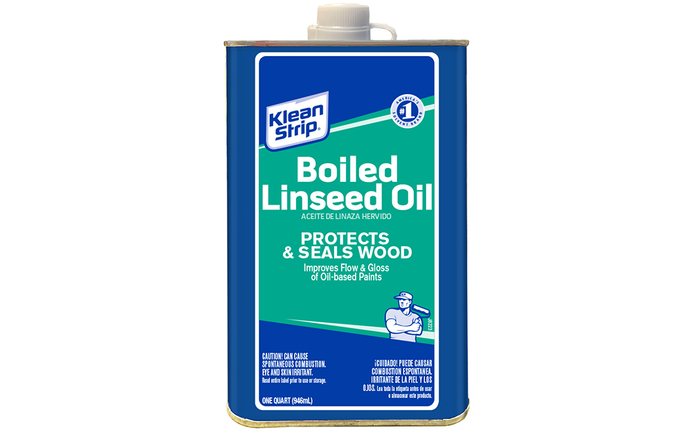A can of linseed oil on a white background.