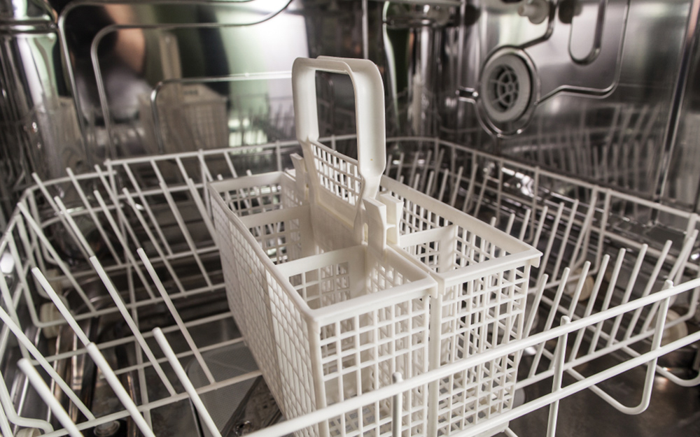 a close up image inside an empty dishwasher