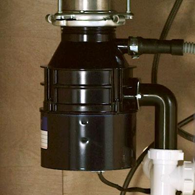 Garbage disposal under a sink.