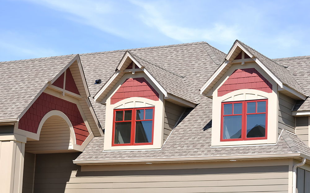 Dormers on the second story of a residence give architectural interest to the home.