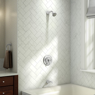 A bathroom with a bathtub and a shower head and faucet.