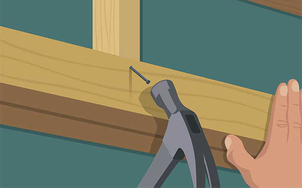 illustration of a person hammering a nail into the header of a door frame